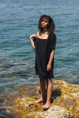 Black linen dress with draped detail